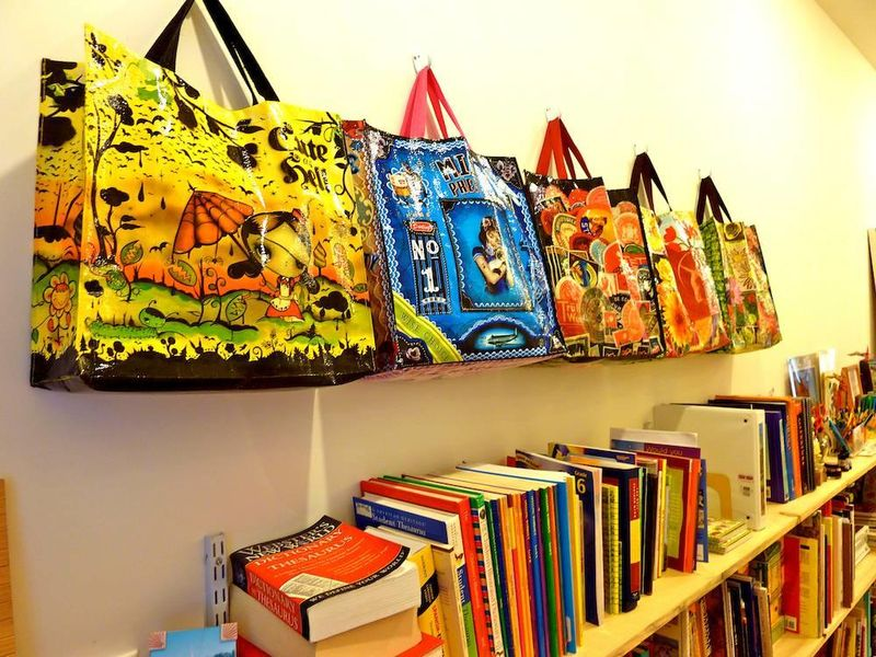 Colorful bags for crafts supplies on wall