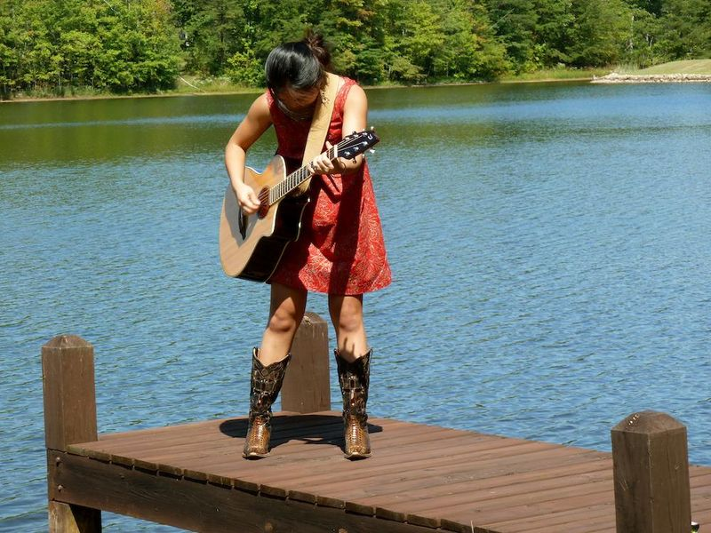 Nica w:guitar on dock