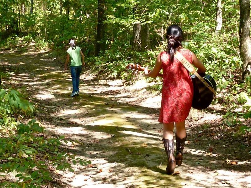Girls walking in the woods:red dress